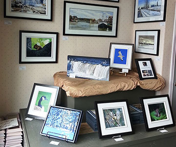 Featured Artist wall at Reflections Art & Framing